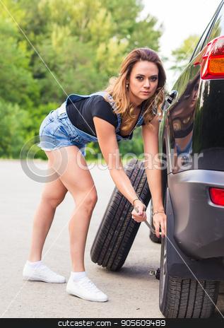 beautiful young woman repairing the car stock photo, beautiful young pretty woman repairing the car by Satura86