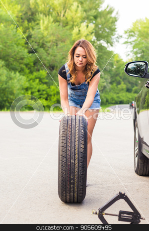beautiful young woman repairing the car stock photo, beautiful young pretty woman repairing the car by Satura86