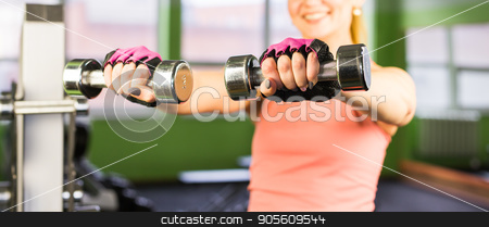 Closeup on fitness woman workout with dumbbell stock photo, Closeup on fitness woman workout with dumbbell by Satura86