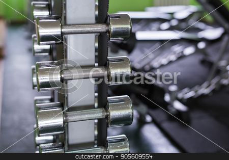 dumbbells in modern sports club. Weight Training Equipment stock photo, dumbbells in modern sports club. Weight Training Equipment by Satura86