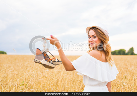 Young woman holding a shoe - sale, consumerism and people concept stock photo, Young woman holding a shoe - sale, consumerism and people concept by Satura86