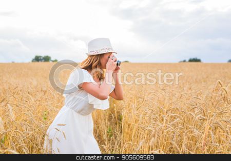 Pretty girl with vintage camera outdoors stock photo, Pretty girl with vintage camera outdoors in nature by Satura86