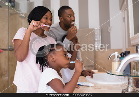 Parents with children brushing teeth in bathroom at home stock photo, Happy parents with children brushing teeth in bathroom at home by Wavebreak Media