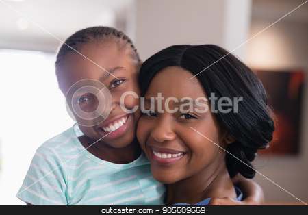 Portrait of happy mother and daughter at home stock photo, Close up portrait of happy mother and daughter at home by Wavebreak Media