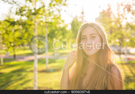 cute smiling girl looking at you stock photo, cute smiling girl looking at you in nature by Satura86