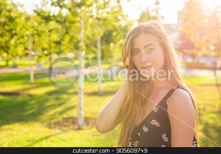 Beautiful young woman in the park. Outdoor portrait stock photo, Beautiful young woman in the park. Outdoor portrait by Satura86