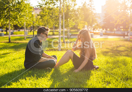 Girl and guy in the park on a sunny day stock photo, Girl and guy in the park on a sunny day by Satura86