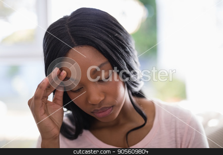 Young woman suffering from headache stock photo, Young woman suffering from headache at home by Wavebreak Media
