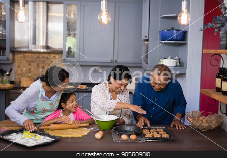 Happy multi-generation family preparing cookies in kitchen stock photo, Happy multi-generation family preparing cookies in kitchen at home by Wavebreak Media