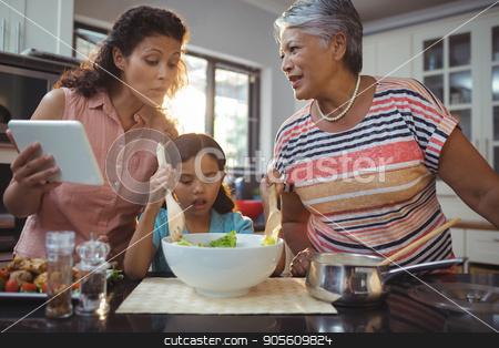 Happy family preparing food in kitchen stock photo, Happy family preparing food in kitchen at home by Wavebreak Media