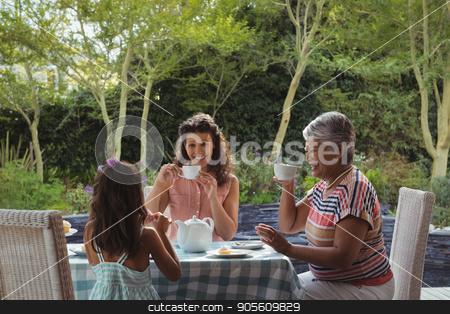 Happy family having tea stock photo, Happy family having tea at home by Wavebreak Media