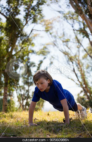 Girl exercising during obstacle course training stock photo, Girl exercising during obstacle course training in the boot camp by Wavebreak Media