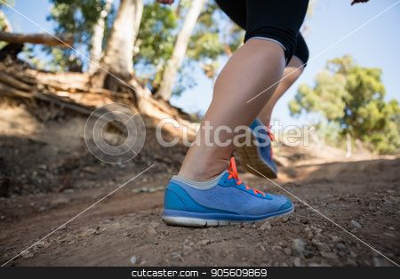 Low-section of woman jogging in the boot camp stock photo, Low-section of woman jogging in the boot camp on a sunny day by Wavebreak Media