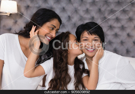 Girl loving mother and grandmother in bedroom stock photo, Girl loving mother and grandmother in bedroom at home by Wavebreak Media