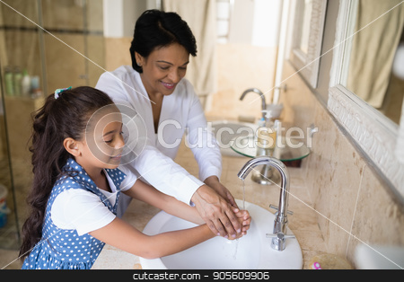 Grandmother and granddaughter washing hands at bathroom sink stock photo, High angle view of grandmother and granddaughter washing hands at bathroom sink by Wavebreak Media