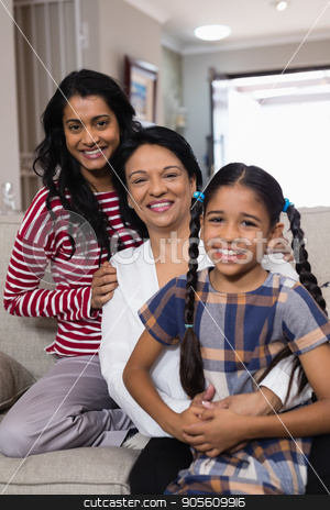 Portrait of smiling multi-generation family in row stock photo, Portrait of smiling multi-generation family in row at home by Wavebreak Media