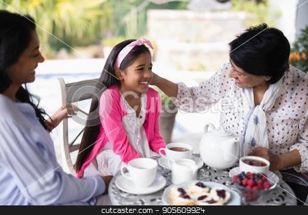 Smiling multi-generation family having breakfast together stock photo, Smiling multi-generation family having breakfast together at home by Wavebreak Media
