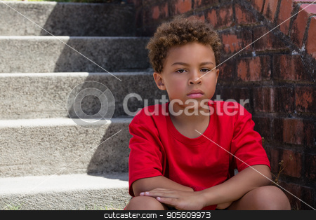 Upset boy sitting on staircase in the boot camp on a sunny day stock photo, Portrait of upset boy sitting on staircase in the boot camp on a sunny day by Wavebreak Media