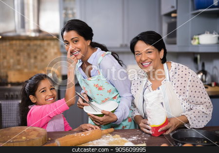 Portrait of cheerful multi-generation family preparing food together stock photo, Portrait of cheerful multi-generation family preparing food together in kitchen at home by Wavebreak Media