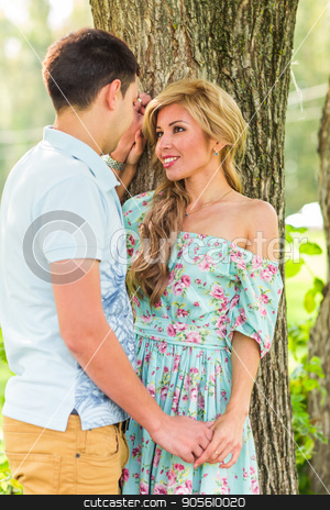 Young couple in love outdoor. Sensual outdoor portrait of young stylish fashion couple posing in summer nature stock photo, Young couple in love outdoor.Sensual outdoor portrait of young stylish fashion couple posing in summer nature by Satura86