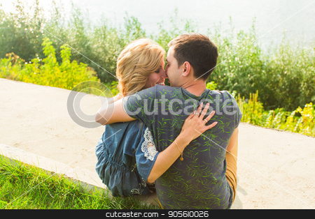 Back view of happy woman hugging her man outside stock photo, Portrait of happy girl hugging her boyfriend outside by Satura86