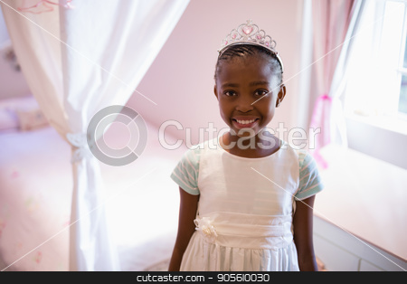 Smiling girl wearing fairy costume in bedroom at home stock photo, Portrait of smiling girl wearing fairy costume in bedroom at home by Wavebreak Media