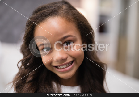 Portrait of smiling girl at home stock photo, Close up portrait of smiling girl at home by Wavebreak Media
