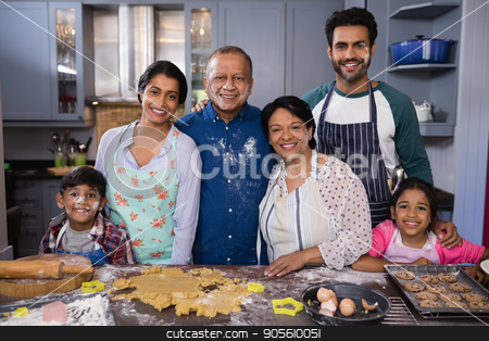 Portrait of smiling multi-generation family standing together in kitchen stock photo, Portrait of smiling multi-generation family standing together in kitchen at home by Wavebreak Media