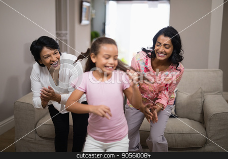 Happy multi-generation family dancing together stock photo, Happy multi-generation family dancing together at home by Wavebreak Media