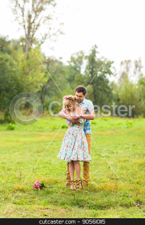 Young couple in love hug each other in nature stock photo, Young couple in love hug each other in nature by Satura86