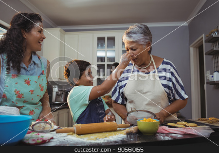 Family preparing dessert in kitchen stock photo, Family preparing dessert in kitchen at home by Wavebreak Media