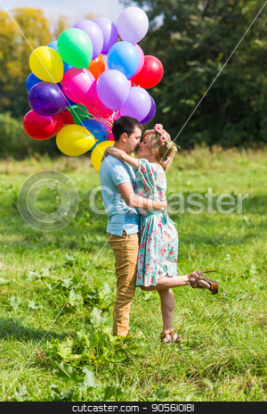 smiling couple in love with balloons in nature stock photo, smiling couple in love with balloons in nature by Satura86