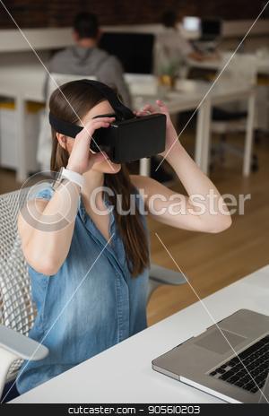 Female executive using virtual reality headset stock photo, Female executive using virtual reality headset in office by Wavebreak Media
