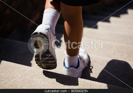 Low-section of kid moving down staircase during obstacle course training stock photo, Low-section of kid moving down staircase during obstacle course training on a sunny day by Wavebreak Media