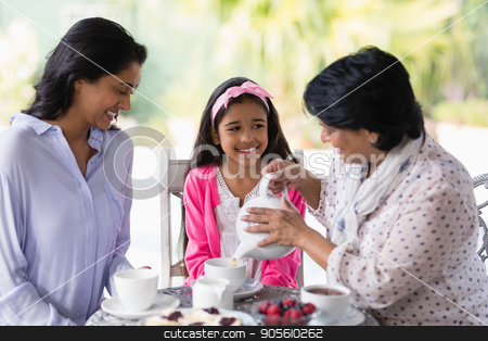 Happy multi-generation family having breakfast together stock photo, Happy multi-generation family having breakfast together at home by Wavebreak Media