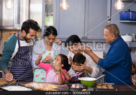 Happy multi-generation family enjoying together in kitchen stock photo, Happy multi-generation family enjoying together in kitchen at home by Wavebreak Media
