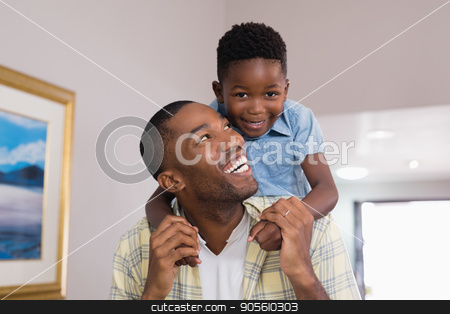 Boy playing with father at home stock photo, Portrait of boy playing with father at home by Wavebreak Media