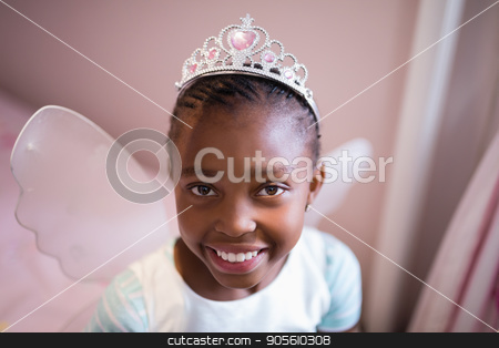 Portrait of smiling girl wearing fairy costume stock photo, Close up portrait of smiling girl wearing fairy costume by Wavebreak Media