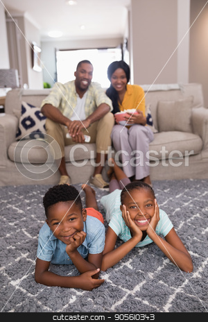Happy family spending leisure time at home stock photo, Portrait of happy family spending leisure time at home by Wavebreak Media