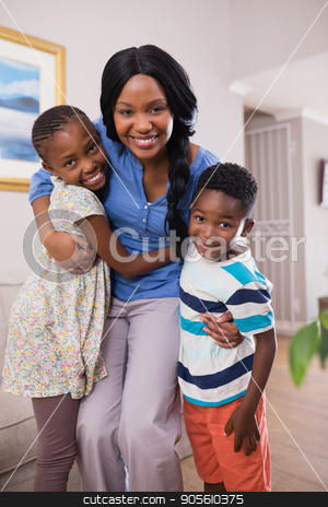 Smiling mother with children at home stock photo, Portrait of smiling mother with children at home by Wavebreak Media