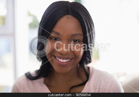 Portrait of smiling young woman stock photo, Portrait of smiling young woman at home by Wavebreak Media