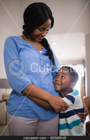 Mother and son embracing at home stock photo, Smiling mother and son embracing at home by Wavebreak Media