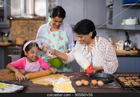 Multi-generation family preparing food together stock photo, Multi-generation family preparing food together in kitchen at home by Wavebreak Media