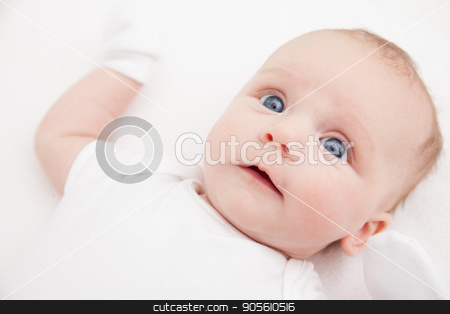 Cute adorable newborn baby girl in white bed and looking at the camera stock photo, Cute adorable newborn baby in white bed and wrapped in blanket and looking at the camera by bvb1981