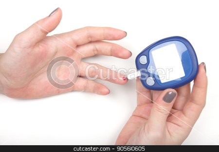 Close-up Of Woman Hands Testing High Blood Sugar With Glucometer stock photo, Woman Hands Testing High Blood Sugar With Glucometer by bvb1981