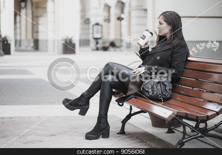 Young Woman drinks coffee outdoors stock photo, Lifestyle young woman with coffee sitting outdoor by bvb1981