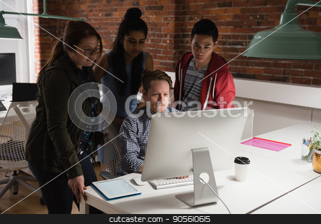 Executives discussing over computer in office stock photo, Attentive executives discussing over computer in office by Wavebreak Media