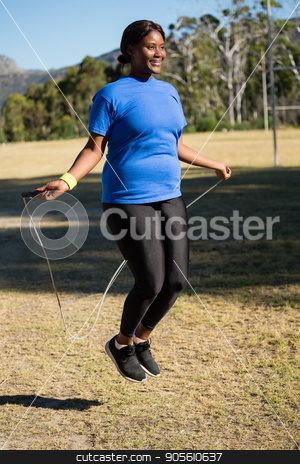 Fit woman skipping rope in the park stock photo, Fit woman skipping rope in the park on a sunny day by Wavebreak Media