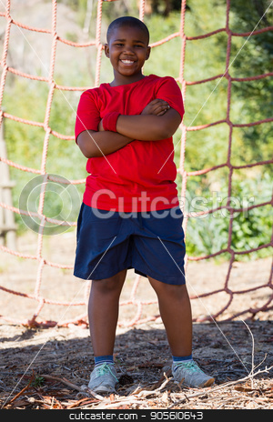 Boy standing with arms crossed during obstacle course training stock photo, Boy standing with arms crossed during obstacle course training in the boot camp by Wavebreak Media