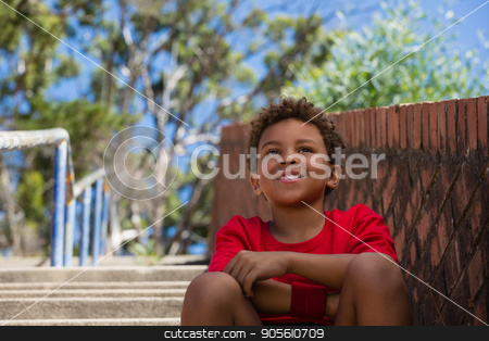 Boy sitting on staircase in the boot camp stock photo, Boy sitting on staircase in the boot camp on a sunny day by Wavebreak Media